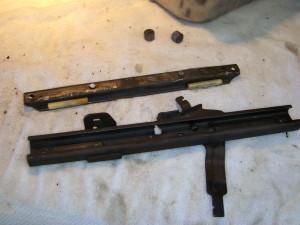 Inside the seat sliding mechanism.